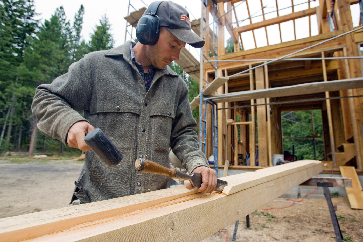 Jonathan Pobst builds a house in Plain, Wash.,  on Aug. 31, 2010, cut from wood from his property and using historic construction methods, including pegs and intricate joinery instead of nails.  (AP Photo/The Wenatchee World, Mike Bonnicksen)